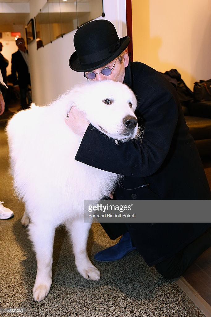 PARIS, FRANCE - DECEMBER 04:  Actor Tcheky Karyo with the dog Berger presents the movie 'Belle et Sebastien' during the 'Vivement Dimanche' French TV Show at Pavillon Gabriel on December 4, 2013 in Paris, France.  (Photo by Bertrand Rindoff Petroff/Getty Images)